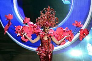 Miss Singapore 2015 Lisa Marie White wears her national costume during filming for the 2016 Miss Universe pageant in Las Vegas on Dec 16, 2015.
