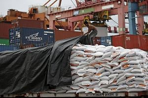 Sacks of rice shipped from Vietnam to Jakarta, Indonesia. If the Asean Economic Community is seen as a single market, it has the potential to be the world's fourth-largest economy.