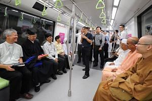 Leaders of Singapore's Inter Religious Organisation taking a private ride on the new DTL2 last Thursday.