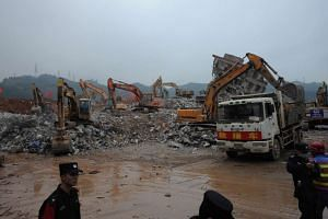 Escavators working at the site of a landslide that hit an industrial park in Shenzhen, south China's Guangdong province on Dec 22, 2015.