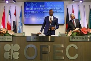Opec's leaders arrive for a news conference after their meeting.