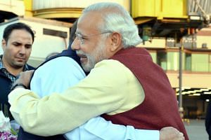 Modi (right) and Sharif hug on meeting in Lahore.
