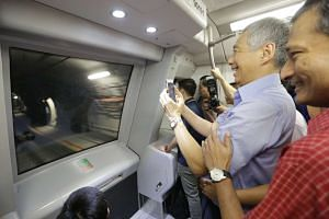PM Lee Hsien Loong, seen here with Dr Vivian Balakrishnan, taking a video during a tour of Downtown Line 2 on Dec 26, 2015.