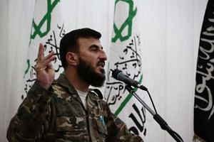 Zahran Alloush (above) was killed in an aerial raid on a base in his Eastern Ghouta stronghold.