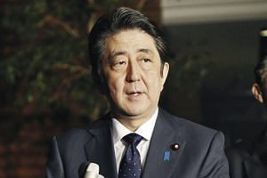 Japanese Prime Minister Shinzo Abe speaking to reporters after South Korea and Japan reached an agreement on the