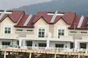 The view of the air wells which resemble crucifixes on the rooftops of a housing project in Kelibang, Langkawi.