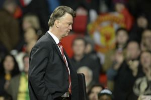 Manchester United's Dutch manager Louis van Gaal leaves the pitch after the final whistle of the match agaihnst Chelsea at Old Trafford on Monday.