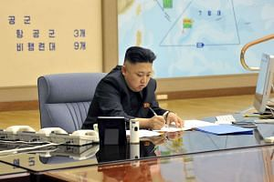 Kim Jong Un presides over a Korean People's Army operation meeting in Pyongyang.