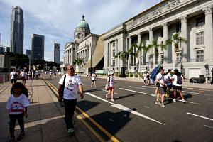 Participants walking past the National Gallery Singapore during the SG50 Jubilee Big Walk 2015 on Nov 29.