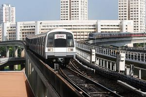 Trains waiting to move into Jurong East MRT station yesterday. SMRT said trains going between Joo Koon and Clementi had to travel at slower speeds owing to the faulty track circuit, which is used to track and control the speed of trains.