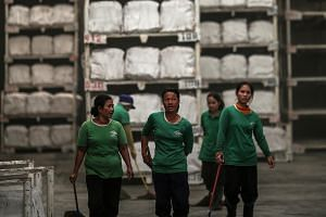 Women workers at a rubber factory in Thailand. In the Asean region, women's educational attainment is lower than men's and continues to remain low despite major interventions on the part of governments to raise it.