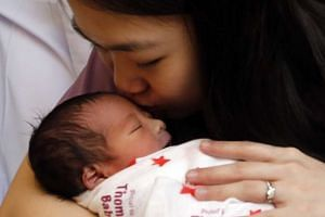 Ms Chen Yi Feng, 30 with baby Evan, who was born at the stroke of midnight on Jan 1, 2016.