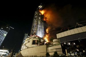 A fire engulfs The Address Hotel in downtown Dubai in the United Arab Emirates on New Year's Eve.