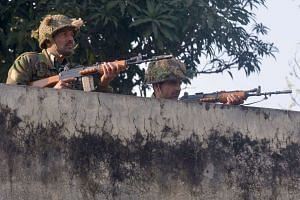 Indian army soldiers taking up position on the perimeter of the air force base in Pathankot on Jan 3, 2016.