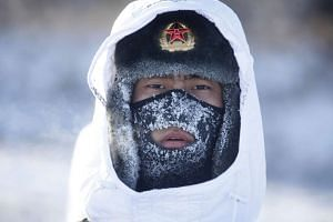 A soldier of China's People's Liberation Army (PLA) takes part in training in temperatures below minus 30 degrees Celsius on Dec 27.