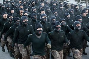 People's Liberation Army recruits shout slogans as they march during a training session in cold winter temperatures at a military base in China's Heilongjiang province. President Xi is pushing on with tough military reforms and an anti-corruption dri