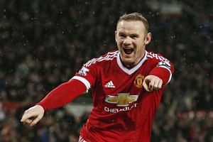 Wayne Rooney celebrates after scoring the second goal for Manchester United.