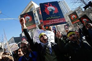 Iranian protestors hold posters of late Shiite cleric Nimr al-Nimr during a demonstration near the Saudi Arabian embassy in Tehran, Iran, on Jan 3, 2016.