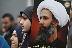 Supporters of Hezbollah and Amel Movement carry pictures of executed Saudi Shi'ite cleric Nimr al-Nimr during a protest in front the UN house in Beirut on Jan 3.