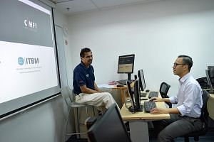 IT trainer Muthu Krishnan (at far left) and student Mohamad Ideal Ismail, who has been in IT for 15 years, both upgrade themselves constantly to keep abreast of industry trends.