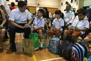 Ng Chee Meng speaks with Primary 1 pupils at Ahmad Ibrahim Primary School during the reopening of school.
