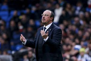 Real Madrid's coach Rafael Benitez reacts during a match against Real Sociedad on New Year's Eve.