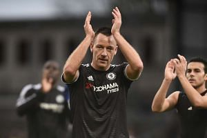 Chelsea's John Terry applauds fans at the end of the match against Crystal Palace on Sunday.