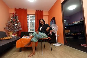 Madam Selvaranee in her two-room flat in Senja Road, which she shares with her two children. She received $60,000 in housing grants, almost halving the effective cost of her flat.