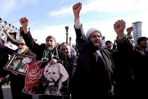 Iranian protesters demonstrating against the execution of Shi'ite cleric Sheikh Nimr al-Nimr, in Teheran on Jan 4, 2016.