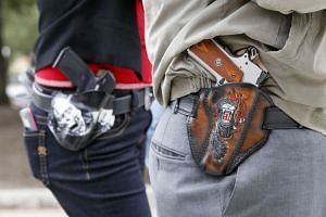 People carrying guns in holsters openly during an open carry rally in Austin, Texas on Jan 1, 2016.