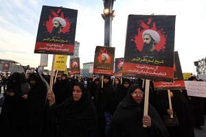 Iranian women gathering during a demonstration against the execution of prominent Shiite Muslim cleric Nimr al-Nimr (portrait) by Saudi authorities on Jan 4, 2016.