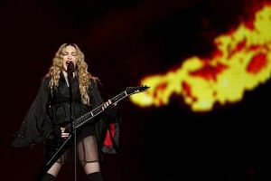 Madonna performing during her concert at the AccorHotels Arena in Paris on Dec 9, 2015.