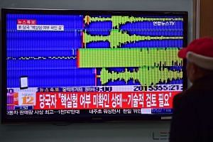 A news report in Seoul on Jan 6, 2016, after seismologists detected a 5.1 magnitude tremor next to North Korea's main atomic test site.