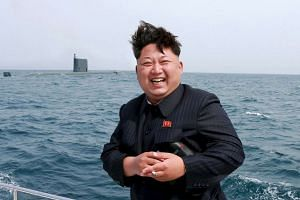North Korean leader Kim Jong Un at a missile test firing.