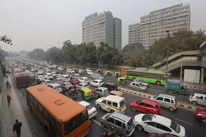 Cars are stuck in traffic on the fourth day of the implementation of New Delhi's pollution-reduction scheme on Jan 4. Under the 15-day trial, private cars are allowed on the roads on alternate days based on their licence plate numbers from 8am to 8pm