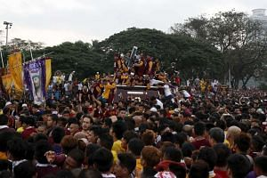 Devotees taking part during the annual procession of the Black Nazarene in Manila on Jan 9, 2016.