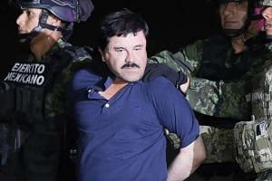 Drug kingpin Joaquin Guzman is escorted to a Mexican Army helicopter in Los Mochis on Jan 8, 2016.