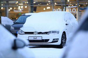 Snow on a used Volkswagen Golf at a VW showroom in Berlin, Germany.