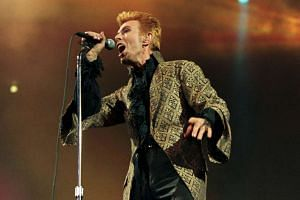 David Bowie performs a song during a concert in Madison Square Garden on Jan 9, 1997.