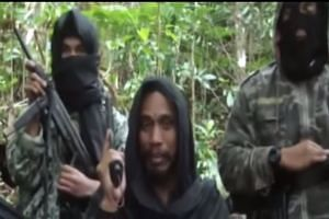 Wanted Indonesian fugitive Santoso (centre) speaking in a YouTube video.