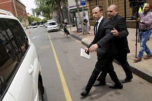 Oscar Pistorius leaves the North Gauteng High Court in Pretoria, South Africa after he was granted bail at his bail hearing on Dec 8, 2015.