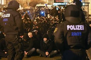 Police detain far-right wing protesters at a far-right Legida and right-wing Pegida rally in Leipzig, Germany, on Monday.