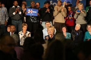 Mrs Hillary Clinton during a campaign stop in Waterloo, Iowa, this week. Her diminishing lead over Vermont senator Bernie Sanders among Democratic primary voters reveals a sharp generational divide within the party, with voters under 45 strongly favo