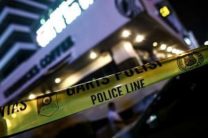 A police banner is seen outside a damaged Starbucks outlet after a series of explosions hit central Jakarta on Jan 14.