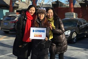 Thousands of people in China have uploaded photos with signs displaying the hashtag D-Strong.