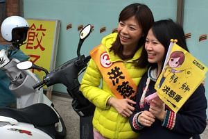 The New Power Party's Hung Tzu-yung (in puffer jacket) on the campaign trail this week.