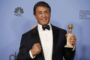Sylvester Stallone with his Best Supporting Actor Golden Globe.