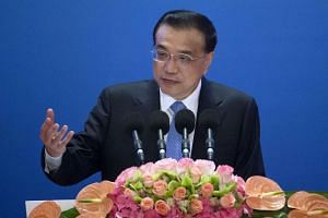 Chinese Premier Li Keqiang speaks during the Inaugural Meeting of the Board of Governors of the AIIB in Beijing.