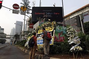 Floral tributes at the bomb blast site in J1 Thamrin in Jakarta. The number of Indonesian fighters estimated to have joined ISIS is between 500 and 700, which seems a lot as a raw number, says the writer, but is small relative to the Indonesian Musli