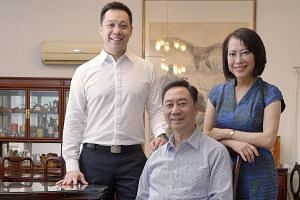 Ms Tay with her husband, Mr Chew, and their son Ken. Ms Tay, who started Primefield to sell WordPerfect and PCs, also started a digital kiosk business in China.